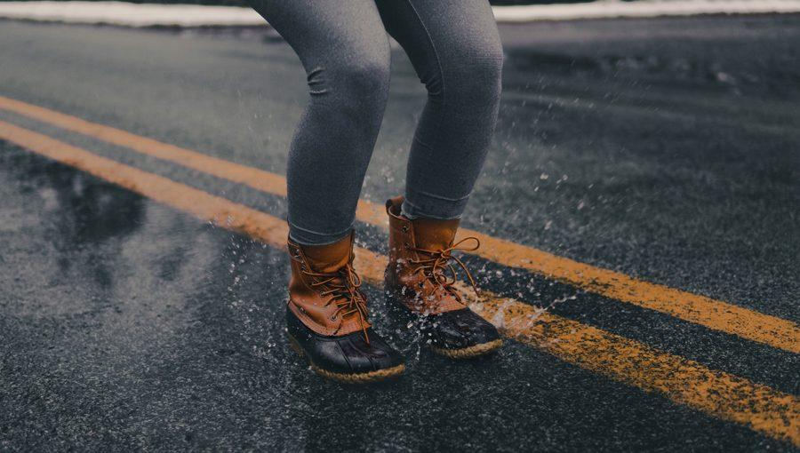 waterproof boots splashing a water