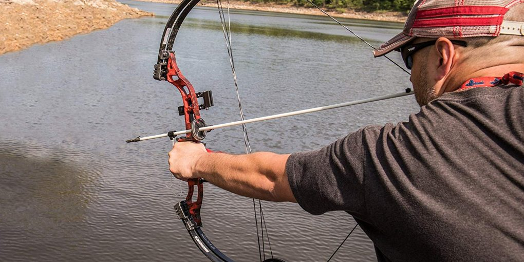 man practice using a crossbow