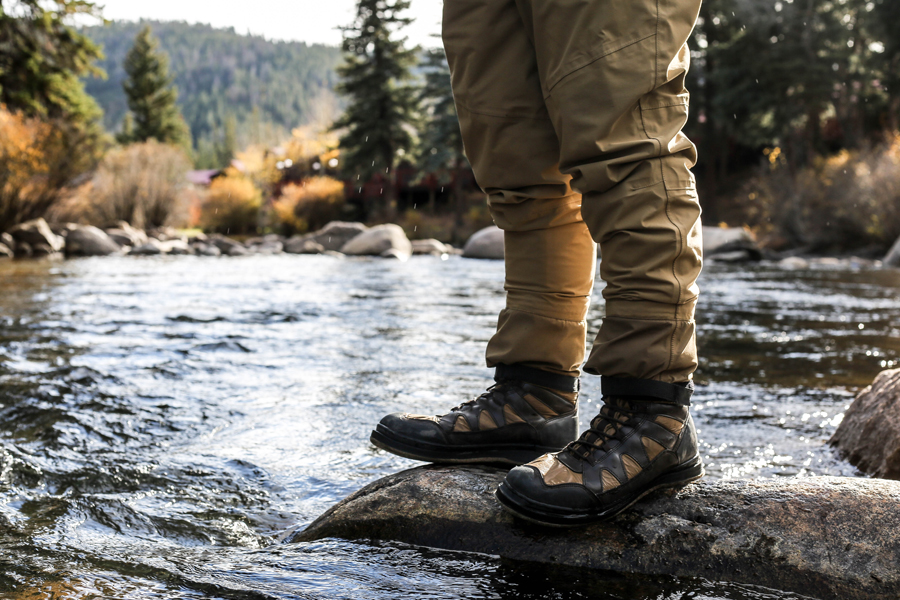 waterproof boots on top of a rock surrounded by water